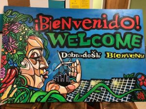 An abstract art YEBO bienvenido welcome mural.